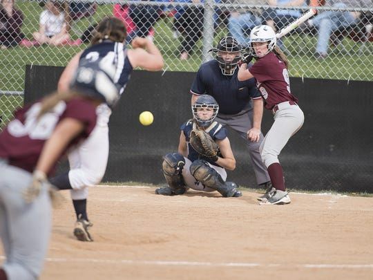 Chambersburg's Leah Hunt, left, delivers a pitch against Shippensburg on Friday. The Lady Hounds were the first team to score an earned run off Hunt so far this season.