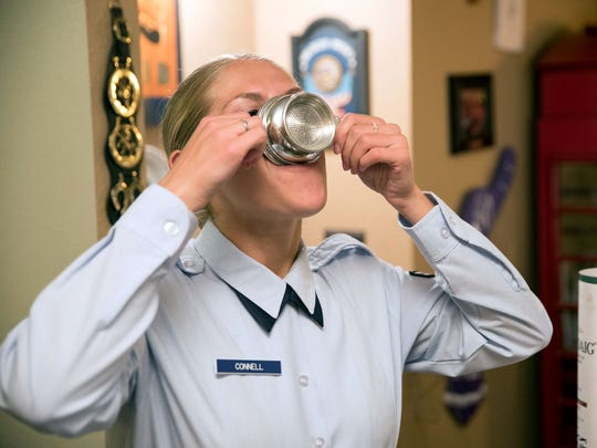 Airman Mariah Connell drinks Laphroaig 10-year scotch from a Scottish quaich in a ceremonial passing of the pipes from her father Michael Connell to her. Michael Connel has been the only military piper in Nevada for many years and now that he's retiring, Mariah Connell will take over.