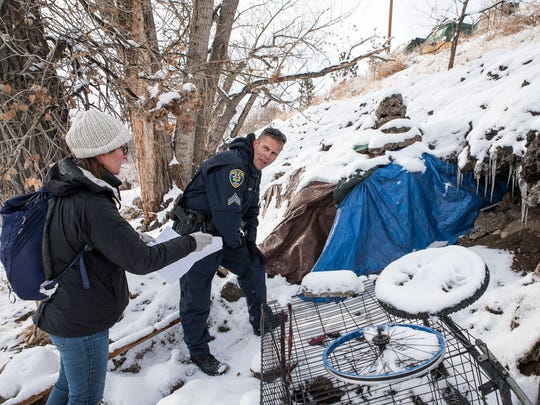 Reno Police Sgt. Wade Clark and volunteers make contact with people living in tents along the Truckee River Jan. 7, 2017 before a forecasted flood.