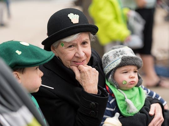 Rhoda Domenic of Milton watches the Wilmington St. Patrick's Day Parade with her grandsons, Emedio Nardone (left) and Angelo Nardone (right) on King Street last year.