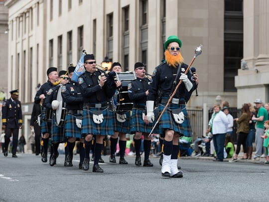 The Wilmington Police Department's pipes and drums march down King Street in the Wilmington St. Patrick's Day Parade last year.