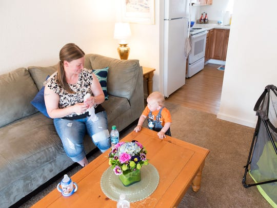 Maria Perry, 36, plays with her son Kaiden Nelson in a new condominium purchased by Jacobs Entertainment and donated to Reno Housing Authority. The public-private partnership is part of a larger goal to secure $2.5 million worth of housing for people in need of affordable living.