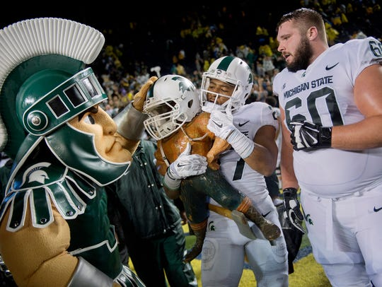 From left, Sparty, Khari Willis, and Casey Schreiner