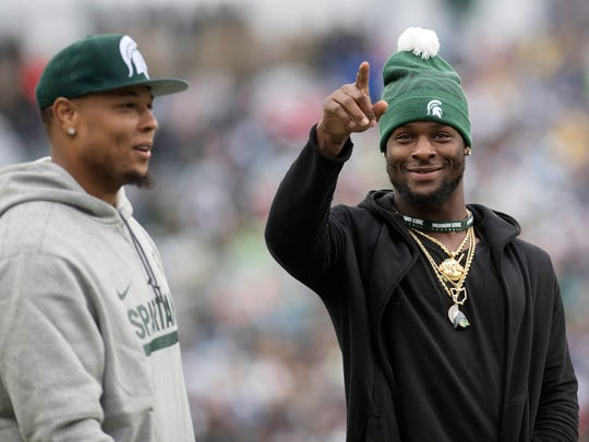 Former Michigan State players Le'Veon Bell, right,