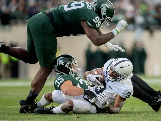 Michigan State's Joe Bachie tackles Penn State's Penn