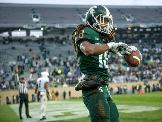 Michigan State's Felton Davis III celebrates his touchdown