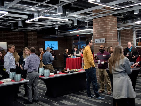 Guests network during Lansing 5:01's Capital Comeback