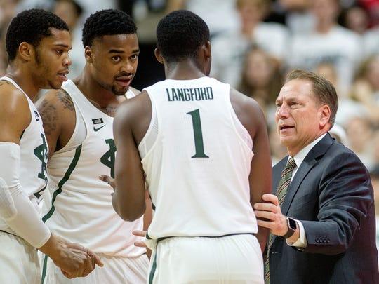 Michigan State head coach Tom Izzo, right, talks with