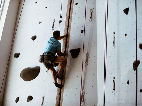 A climber scales the indoor climbing walls at Mesa Rim fitness center in Reno.