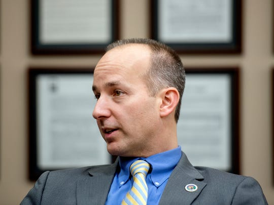 Lansing Mayor-elect Andy Schor talks during an interview