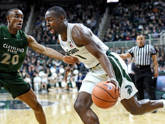 Michigan State's Joshua Langford, right, looks for