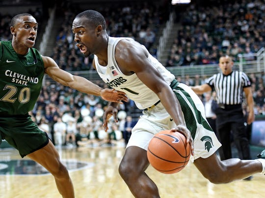 Michigan State's Joshua Langford, right, looks for room as Cleveland State's Bobby Word defends during the first half on Friday, Dec. 29, 2017, at the Breslin Center in East Lansing.