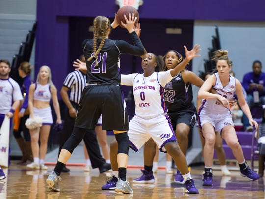 Northwestern State's Nautica Grant (0) defends against Stephen F. Austin's NSU 0 Nautica Grant SFA 21 Stevi Parker (21) as the Lady Demons take on the Ladyjacks Saturday Jan. 6, 2018.