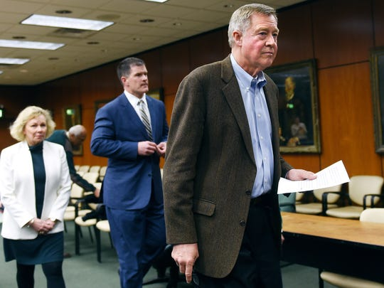 Michigan State University Board of Trustees Chairman Brian Breslin, right, leaves the podium after reading a statement regarding MSU President Lou Anna K. Simon during a press conference on Friday, Jan. 19, 2018, in the Hannah Administration Building on the MSU campus in East Lansing.