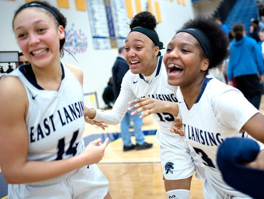 From left, East Lansing's Aazh Nye, Jaida Hampton and