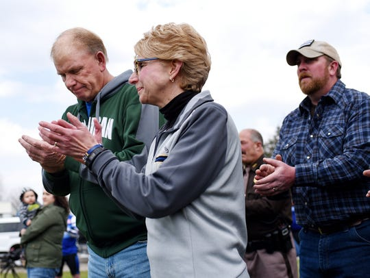 From left, Clyde and Mary Whitaker clap after remarks
