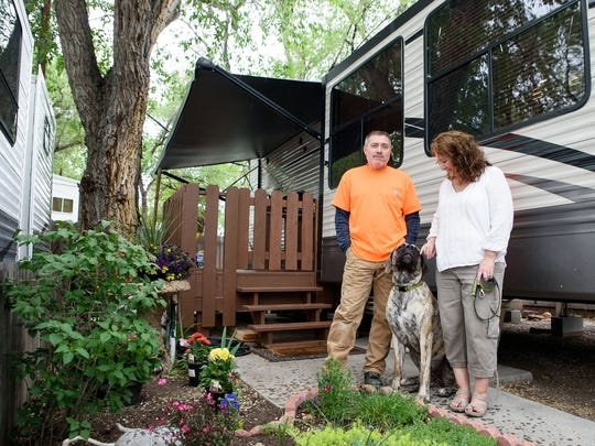 David and Devon Townsend pose with their dog Bella in front of their park-model trailer at the River West Resort RV and trailer park. Devon's mother helped set up a front yard garden while visiting this week.