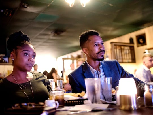 Elvin Caldwell, right, and Angela Hill listen to music