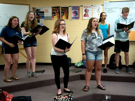 Senior Calista Cremeans, left, sings with her classmates