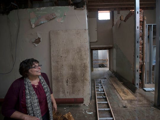 Janet Pollard, executive director of Franklin County Visitors Bureau, is renovating a building they will move to on Memorial Square.