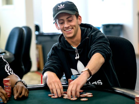 Nick Barchichat, 20, a Fenton native, said he sometimes spends up to six hours at The Event Spot poker room in Delta Township. Barchichat wants to see more poker rooms in the Lansing area.