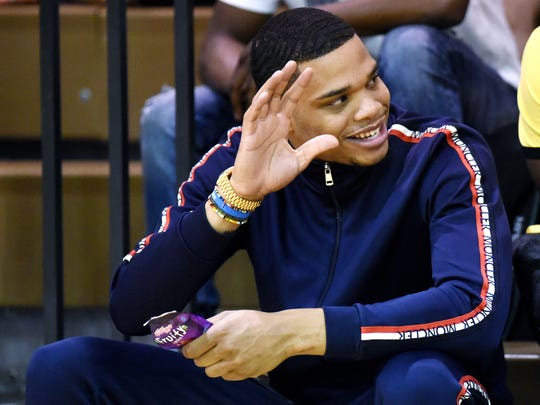 Former Michigan State University star Miles Bridges waves to a fan on Thursday, June 28, 2018, during a Moneyball Pro-Am summer basketball league game at Aim High in Dimondale.