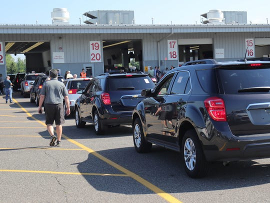 Cars are lined up to head to the auction floor at Manheim