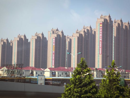 Mega-apartment buildings are being built in the Shanghai area.