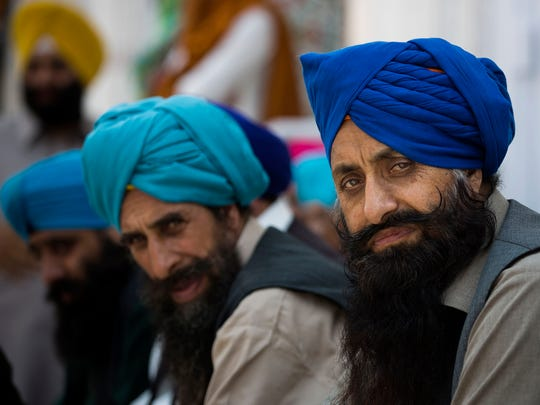 Sikh pilgrims attend a religious festival in Hasan Abdal near Islamabad in Pakistan, Tuesday, April 14, 2015. Sikh pilgrims arrived from neighboring India and other countries to attend the religious festival 'Besakhi' at a shrine of Gurdwara Punja Sahib, the second most sacred place for Sikhs. (AP Photo/B.K. Bangash)