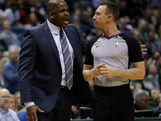 Indiana Pacers head coach Nate McMillan argues a call during the first half of an NBA basketball game against the Milwaukee Bucks Wednesday, Jan. 3, 2018, in Milwaukee. (AP Photo/Morry Gash)