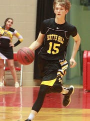 Scotts Hill's Wade Tubbs dribbles the ball Friday during a game against Madison Acdemic.