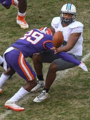 Clemson cornerback Marcus Edmond (29) hits The Citadel