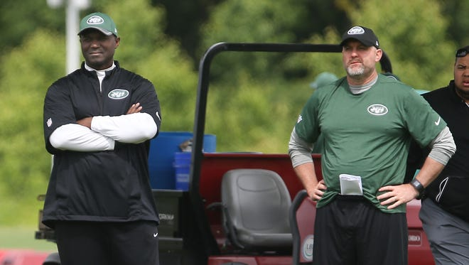 Jets head coach Todd Bowles (left) and offensive coordinator John Morton (right) watch organized team activities at the Atlantic Health Jets Training Center.