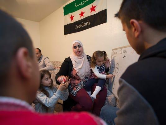 Zana Alattar with Syrian refugees