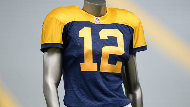The new third uniform was unveiled during the annual shareholders meeting at Lambeau Field July 28, 2015. The jersey is a re-creation of the team's uniform from 1937-49, a special time in Packers history in which they won two of their record 13 NFL championships. The jerseys will be navy blue and gold, the Packers' predominant color scheme over their first three decades; and their design will include a gold yoke across the shoulders, the distinctive feature of their uniforms from 1937-49.