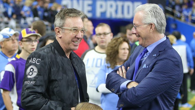 Comedian and actor Tim Allen talks with Detroit Lions president Rod Wood, right, before a game Nov. 24, 2016, at Ford Field in Detroit.