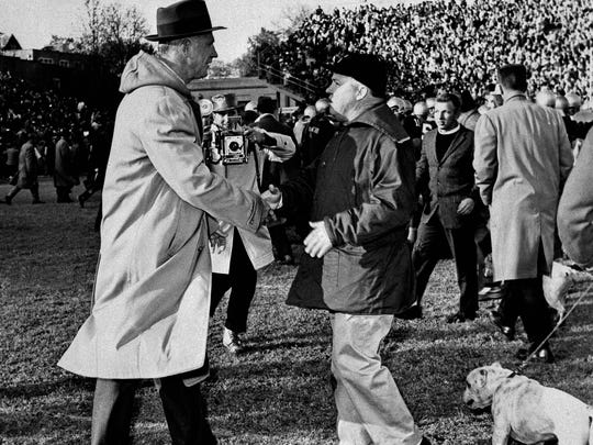 Georgia Tech coach Bobby Dodd, left, shakes the hand of Georgia coach Wally Butts on Nov. 28, 1959. Dodd later pulled Georgia Tech out of the SEC.