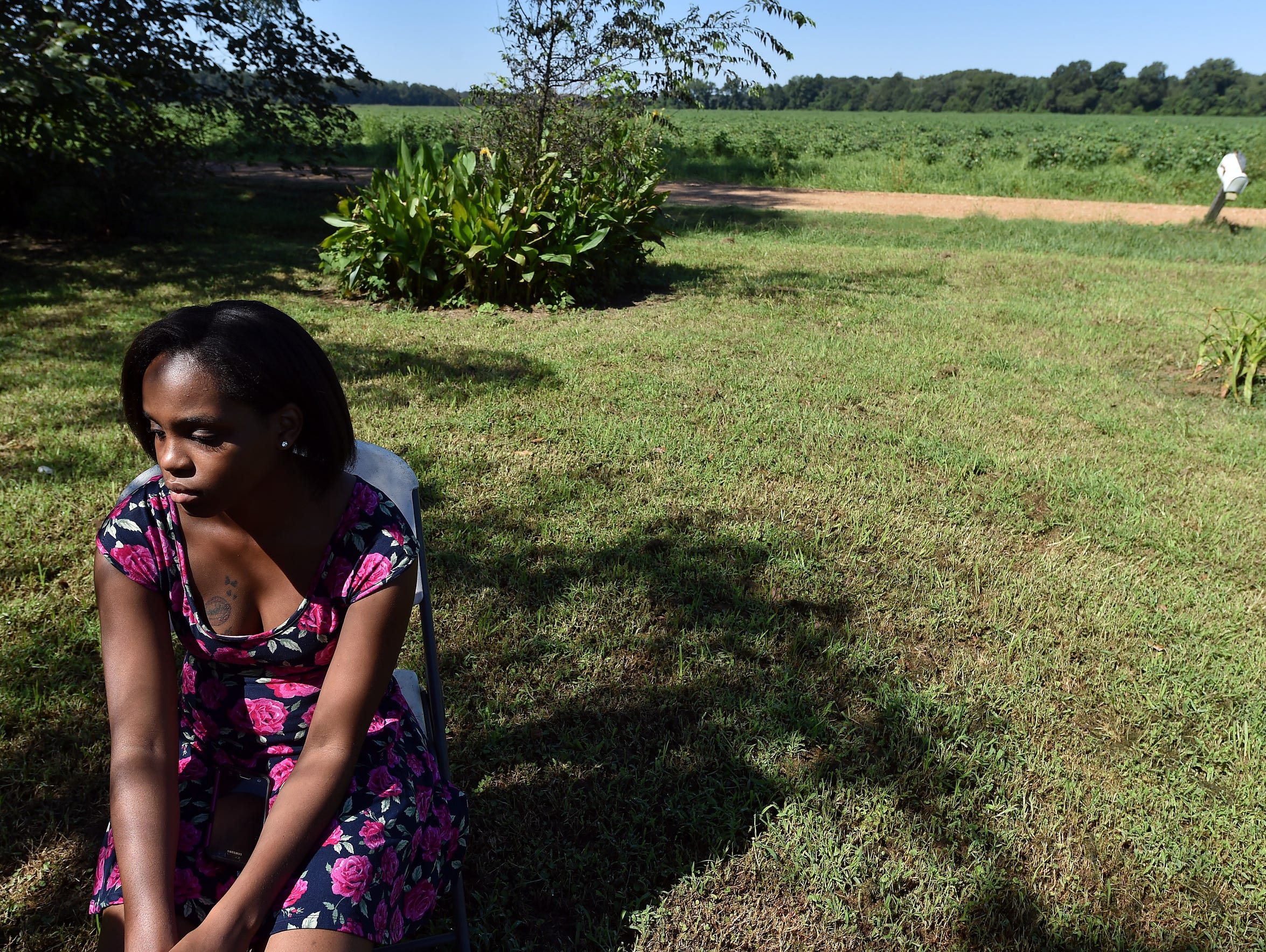 Antoinette Spann sits outside her Mileston home, directly
