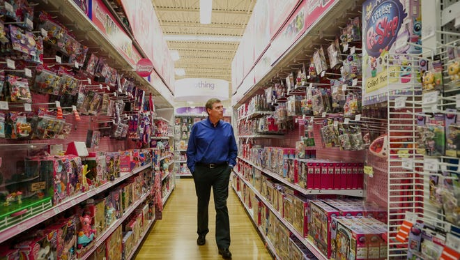 "Dave Brandon, chief executive officer of Toys ""R"" Us, walks an aisle in Secaucus, New Jersey, on Aug. 19. He took over 14 months ago."
