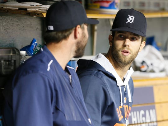 Detroit Tigers off day pitchers Justin Verlander, left, and Daniel Norris talking in the dugout in the late innings of their 2-1 win over the Kansas City Royals on Wednesday, August 5, 2015, in Detroit.