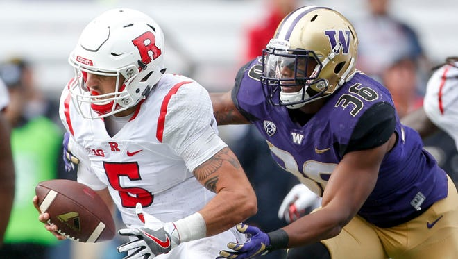 Washington linebacker Azeem Victor (36) pressures Rutgers quarterback Chris Laviano (5) during the first quarter at Husky Stadium.