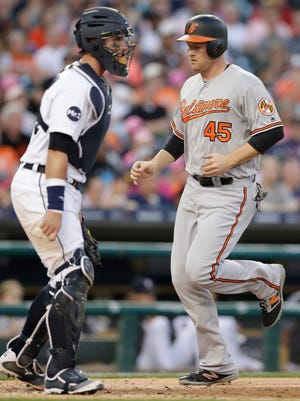 Orioles designated hitter Mark Trumbo scores on a single by Welington Castillo during the fourth inning Wednesday at Comerica Park.