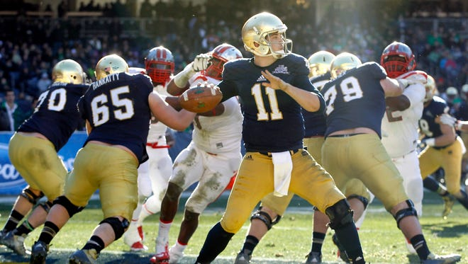 Notre Dame quarterback Tommy Rees drops back to pass in the first half of the Pinstripe Bowl at Yankee Stadium.