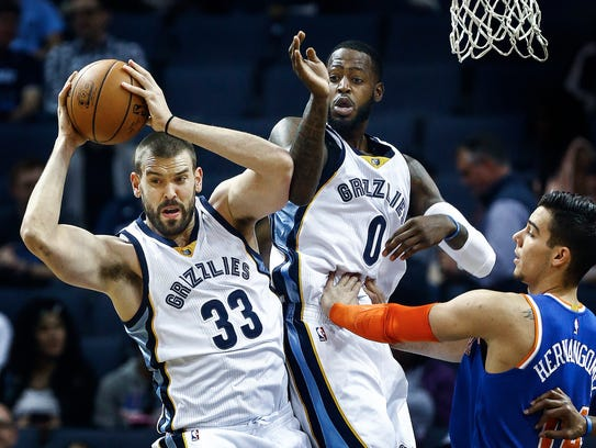 Memphis Grizzlies center Marc Gasol (left) grabs a