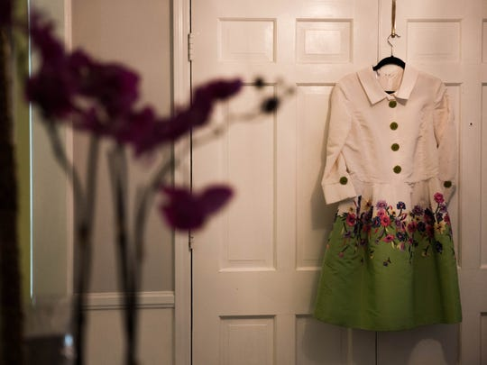 This silk Oscar de la Renta dress by Bergdorf Goodman with green porcelain buttons and needlepoint flowers is one of Winkie Dawkins' favorites. with June 20, 2017.