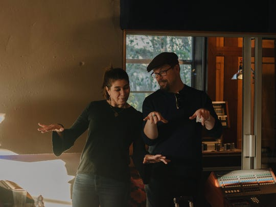 Yvette Landry, left, and piano ace Eric Adcock work