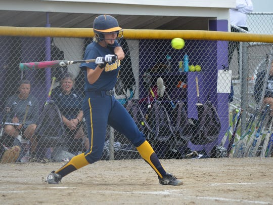 Nina Bennett of Grand Ledge takes a swing during this