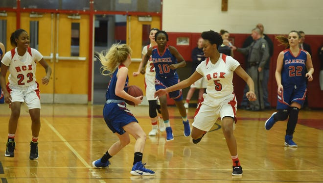 Ketcham's Jada Rencher, right, defends while Carmel's Kate Crawford, left, looks for an open teammate during a game on Jan. 11.