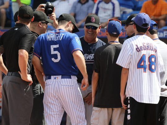 Brian Snitker, manager of the Atlanta Braves and David Wright of the Mets exchanged the batting line ups before the game and along with them  were students from the Stoneman Douglas High School, scene of last week's shooting in Florida. The Mets played their first game of the exhibition season.
