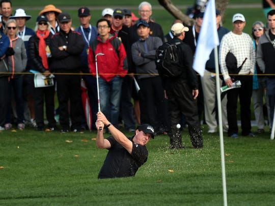 Phil Mickelson hits his ball out of a bunker on 16 at the La Quinta Country Club during the 1st round of the CareerBuilder Challenge on Thursday, January 19, 2017.
